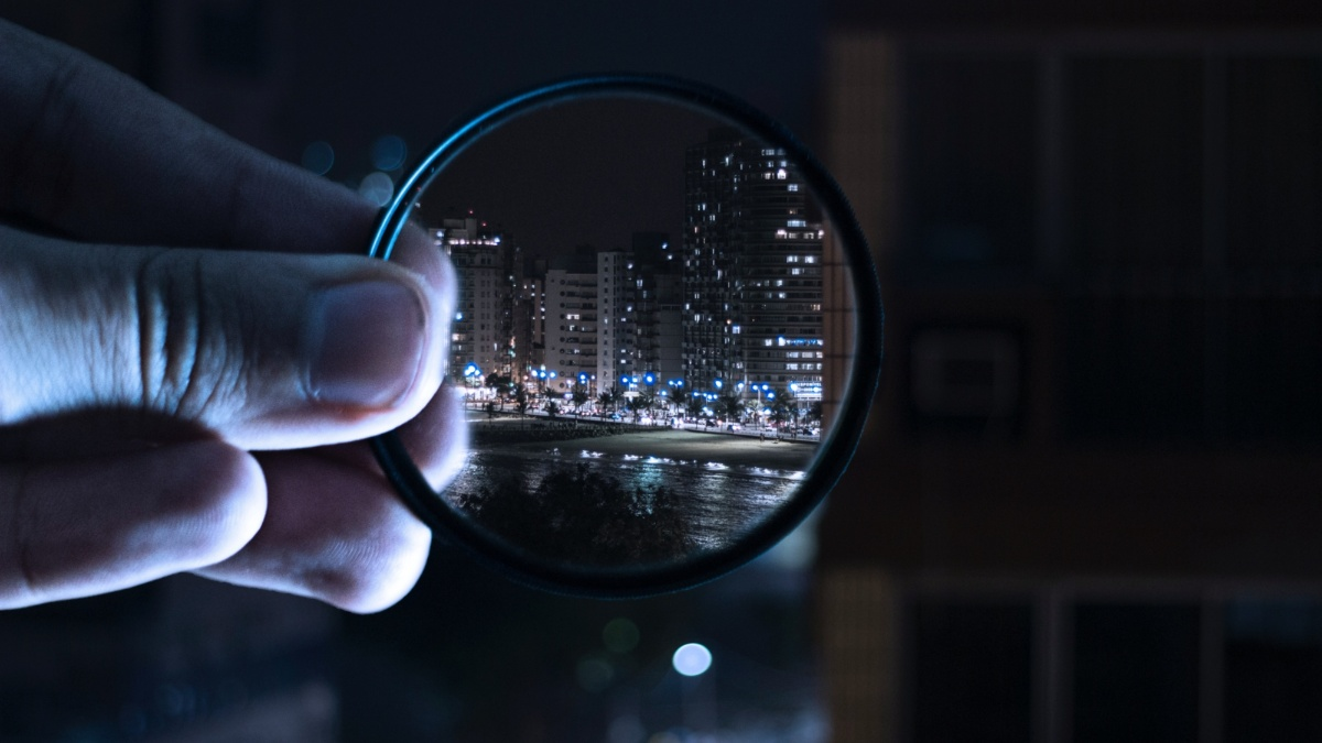 Looking through glasses at a city by night