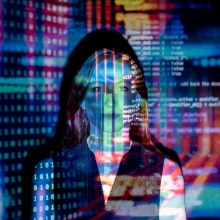 Woman in colorful coding-light