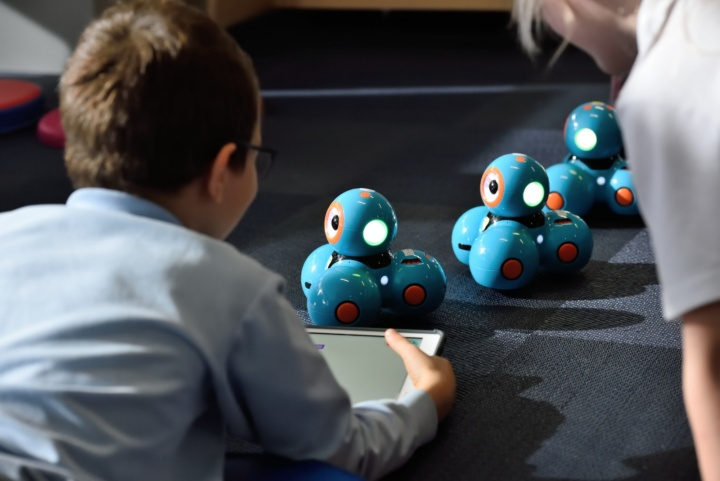 Child playing with a robot